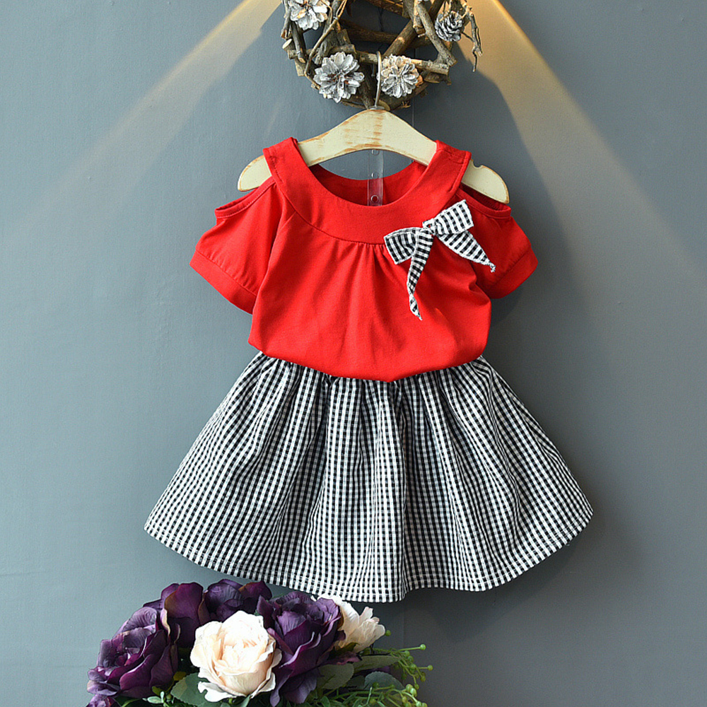 Купить со скидкой Baby / Toddler Girl Bow Decor Armhole Solid Short-sleeve Top and Plaid Skirt Set